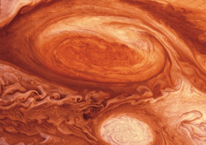 Jupiter's Great Red Spot, a storm system bigger than Earth, may be powered by a deep heat source.