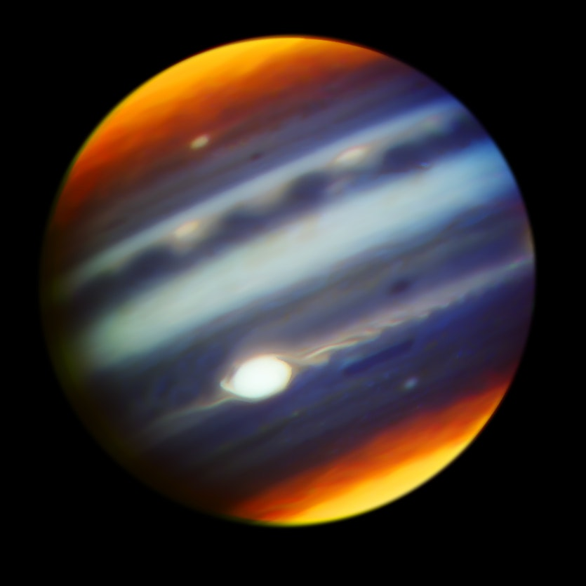 A composite infrared image of Jupiter in wavelengths between 1.69 and 2.275 microns.
