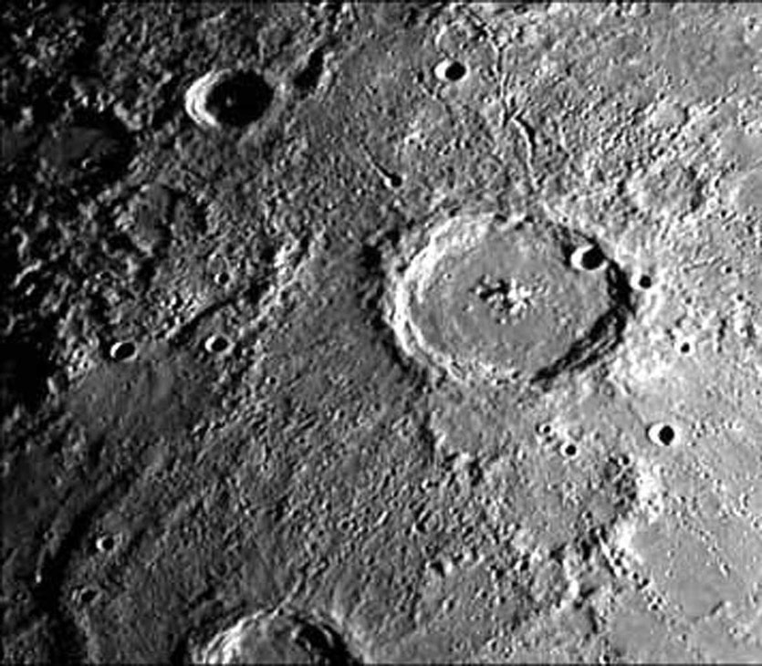An image from Mariner 10's first encounter with Mercury, showing a 140 km wide crater and its surrounding zone of secondary craters.