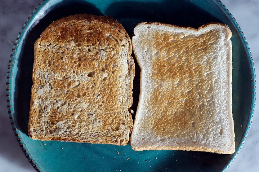 Two slices of toast: one white, one wholemeal.