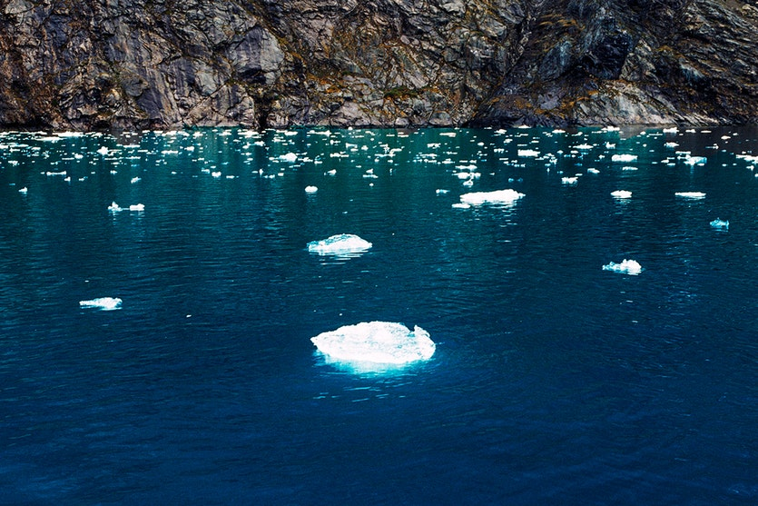 Broken pieces of glacier ice floating in the waters of Greenland's Fjord of Eternity.