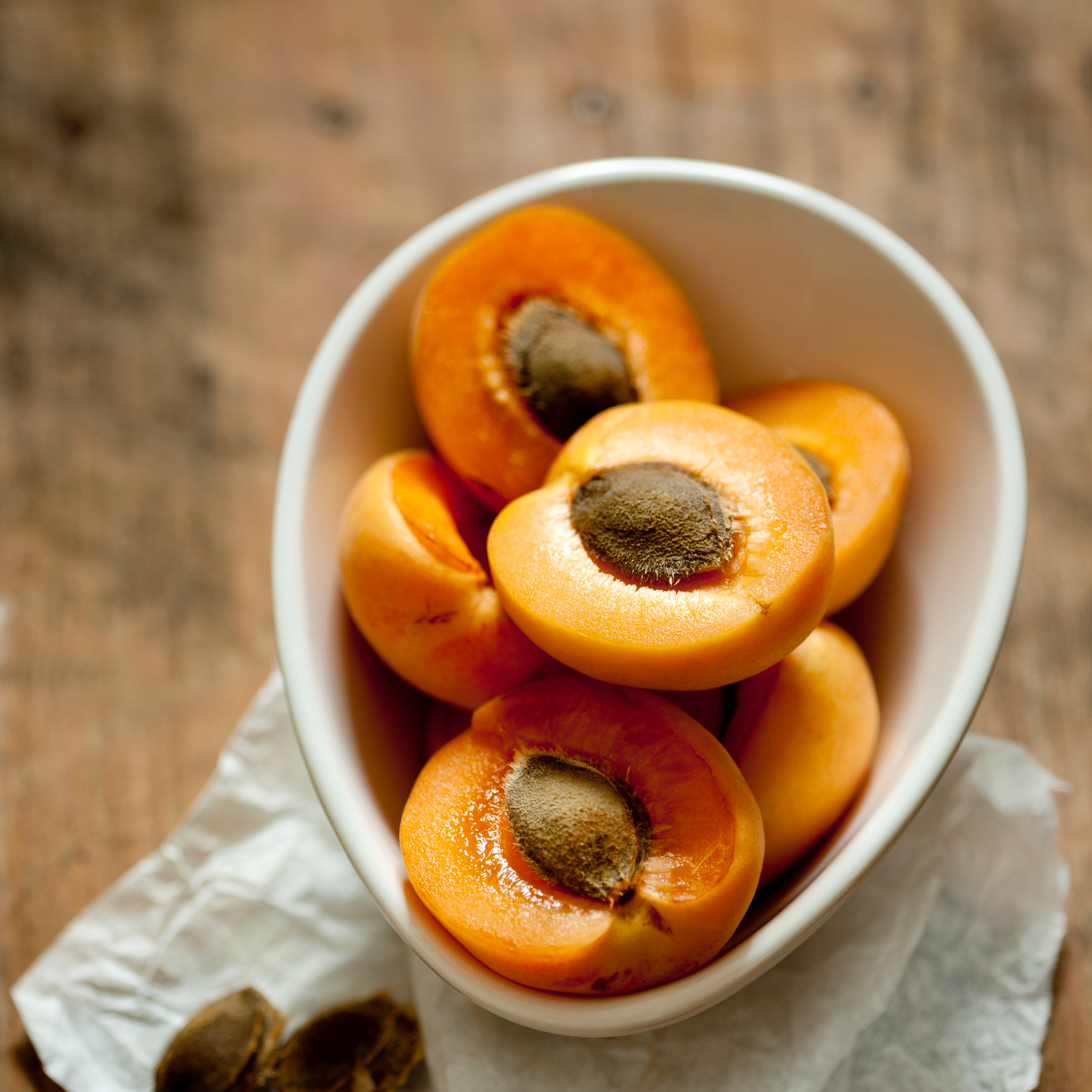 A bowl of halved apricots.