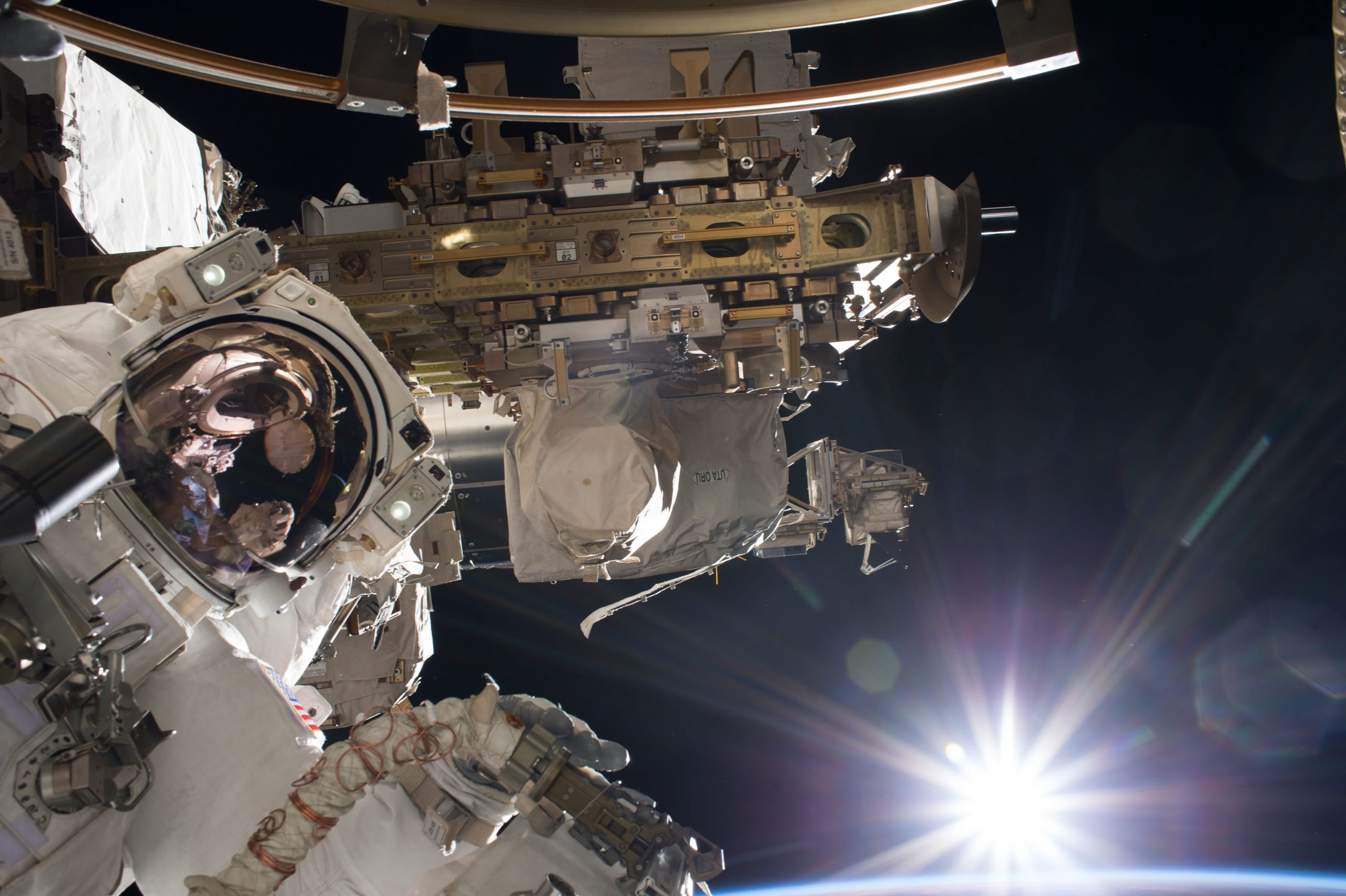 Astronaut Mark Vande Hei outside the International Space Station.