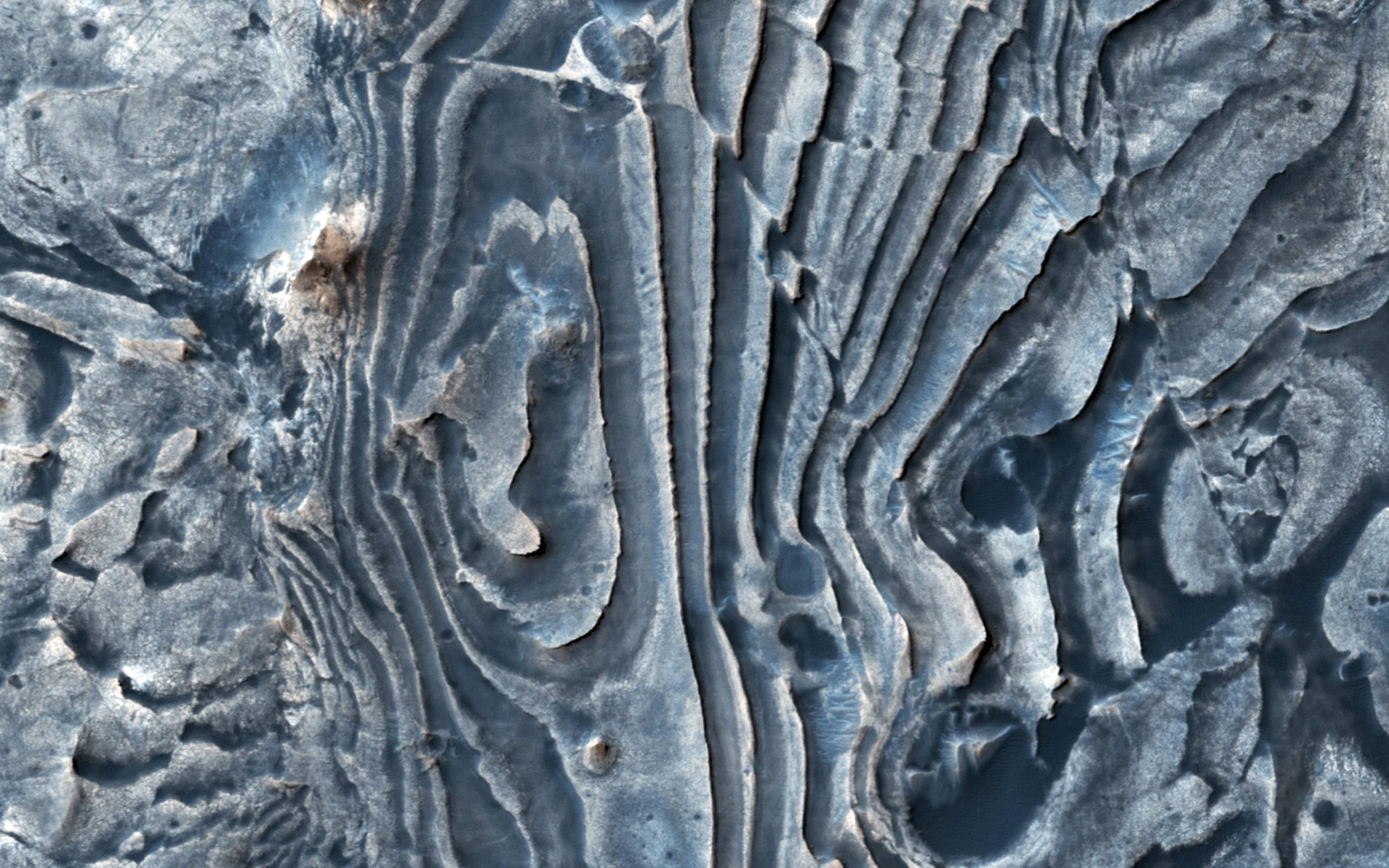Faulted layers in the Martian ground.