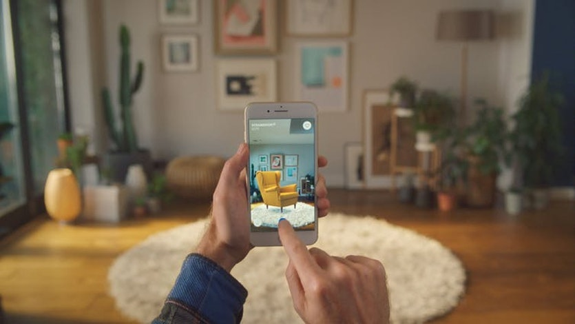 IKEA Place is an augmented reality application that lets people experiment with how furniture would look in their home before they buy it.