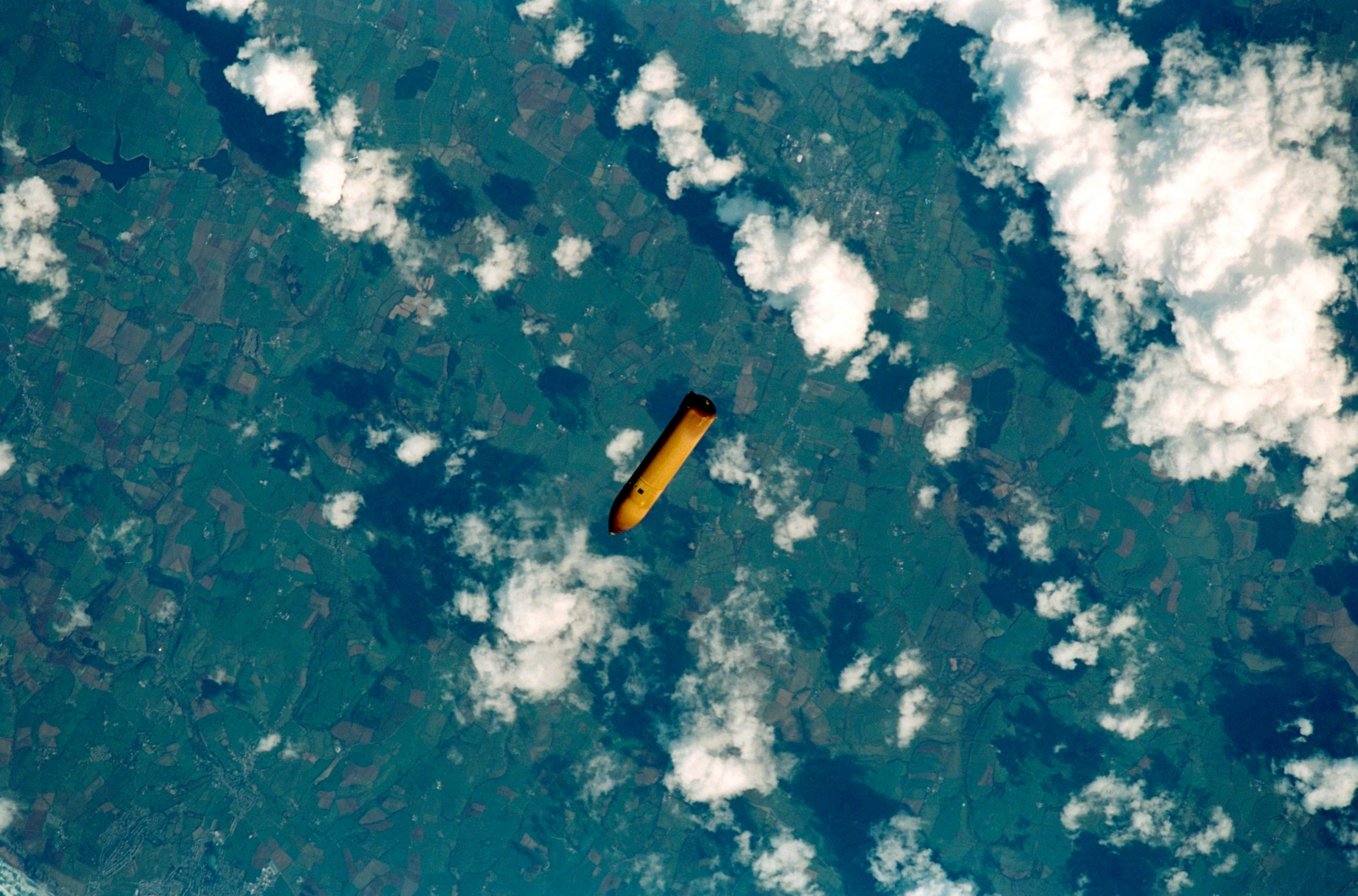 The external tank from STS-102 falls to Earth.