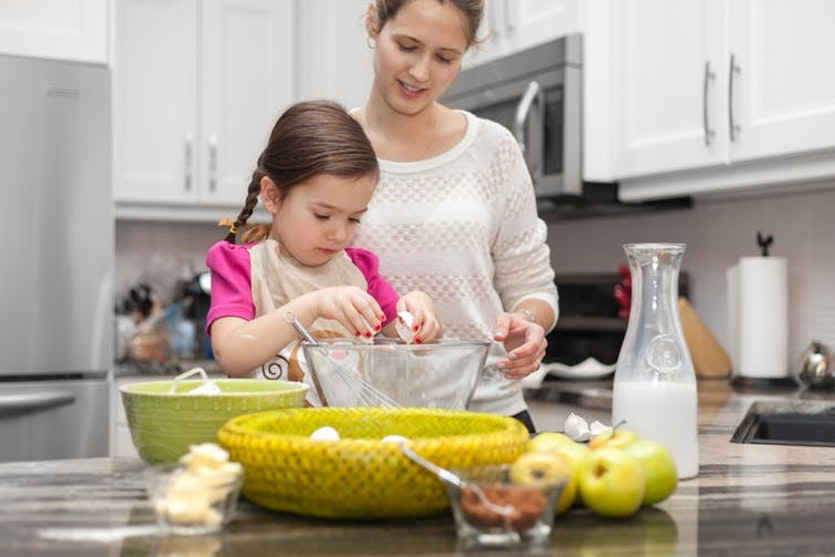Parents can teach their child that 'one' means one object by asking them to, for example, collect two eggs for the cake mixture. =