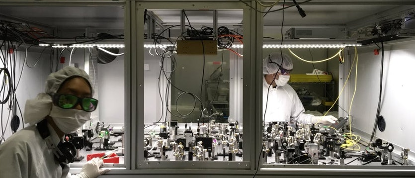 Australian National University scientists Nutsinee Kijbunchoo and Terry McCrae build components for a quantum squeezed light source at LIGO Hanford Observatory in Washington, US.