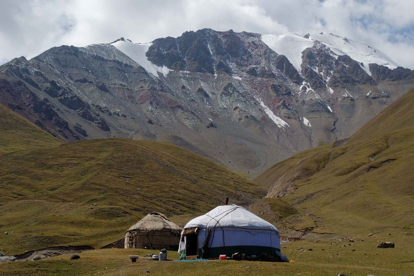Yurts set up for the summer season in Kyrgyzstan's Alai Valley. Many Kyrgyz are trying to revitalise their nomadic traditions in order to adapt to climate change.