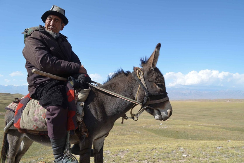 As a shepherd, Halnazar Turduev, bundled in winter clothes, remembers warmer days as a boy in the Alai Valley.