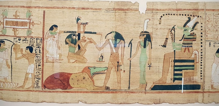 A scene from the Books of the Dead (The Egyptian Museum) showing the ibis-headed God Thoth recording the result of the final judgement.