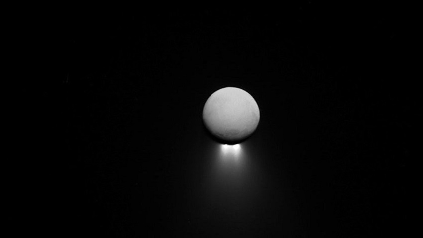 Saturn's moon Enceladus with the Sun behind it. Are there oceans in the picture as well?