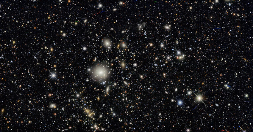 """Ten areas in the sky were selected as """"deep fields"""" that the Dark Energy Camera imaged several times during the survey, providing a glimpse of distant galaxies."""