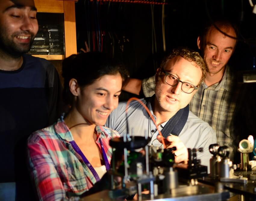 UQ team researchers (counter-clockwise from bottom-left) Caxtere Casacio, Warwick Bowen, Lars Madsen and Waleed Muhammad aligning the quantum microscope.